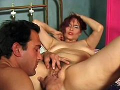 Salacious redhead milf Gina Delvaux is having fun with some guy in a bedroom. She gives a blowjob to the man, then takes his wang into her hairy twat and enjoys banging in cowgirl position.