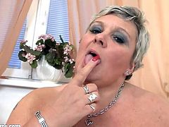 Granny with big tits masturbate