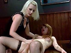 Redhead Claire is receiving one hell of an ass slapping from the hot blonde Cherry. The blonde wants to give her a woman's touch and dominates this bitch just the way she deserves it. She slaps that sexy booty until it turns red, gapes her pussy and then puts her down on the floor for more