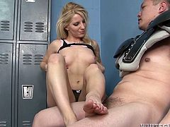 Desperate slut gets in men's changing room. She kicks dude's balls so strong man is easily defused. She then strips in front of him. Later on she gives him awesome footjob.