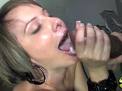 She is in public toilet fingering and rubbing her shaved cunt and then dong comes out from hole. She sucks that big cock and then put it in her clam.