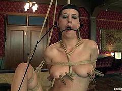 Bella Rossi and Cherry Torn show their nude bodies to their master. Then he ties them up and fixes clothespins to their tits.