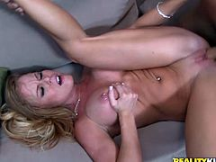 Enjoy this blonde cougar, with big love pillows wearing sexy secretary clothes, while she gets nailed roughly over a couch by man in a suit!