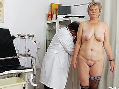 This old lady goes to the doctor to get her vagina checked out. He takes her measurements and then puts on his gloves. He sticks his fingers inside her to make sure everything is all right. He spreads her pussy lips nice and wide.