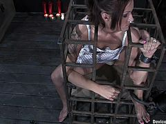 Sexy girl get released from the cage and then tied up. She also gets blindfolded and tortured with claws fixed to her nipples.
