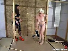 Kym Wilde is playing BDSM games with lewd blonde Lorelei Lee. Kym attaches weights to Lorelei's tits and then fingers her ass and beats her with a lash.