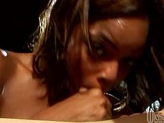 No other slut can please cock with mouth like this black chick does. She sucks this stud's stiff cock with unrestrained passion paying special attention to his balls. Then he fucks her wet pussy in missionary position.