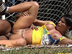 Dani Lopez the slutty Brazilian chick plays soccer. She gets very horny. So, she takes her uniform off and starts to suck big black cock. Later on she also gets fucked on the field.