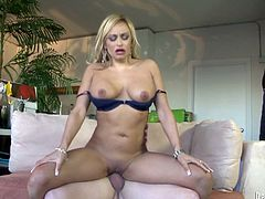 This charming and luscious blond milf with a fine ass gets her man naked and starts sucking his penis! It gets hard and ready to poke her twat.