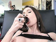 Nora Noir enjoys the warmth of guys hard worm in her hands
