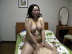 A chubby Japanese mature such as this one is surely deserving out time and attention. This slut likes it on top and she rides this guy for us in front of the camera. Watch her bouncing tits on top of him and enjoying every inch of dick he has, deep in her pussy. Perhaps this slut will be filled with his cum.