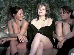 Nasty blonde girl gets captured by two mistresses in the country. She gets tied up and and clothespinned. Then she licks pussies and gets toyed rough.