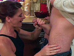 Watch this horny milf seducing her son's friend in her home.She sits on her knees and sucks his hard young cock deep then spreads her legs and let him fuck her lusty hairy pussy hard till she is all wet.