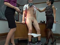Kinky teachers whip guy's ass and then tie him up. After that they also drill his ass with huge strap-on. This guy also licks their pussies.