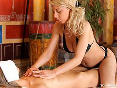 She relaxed and let her masseuse use her talented hands work. After the rubdown the masseuse oiled up her ass and pussy then fingered her.