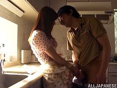 Take a look at this hot scene where the horny housewife Akari Asahina jerks her man's hard cock before blowing him in the kitchen.