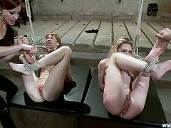 Submissive blonde chicks get tied up and clothespinned by their mistresses. Later on they also get spanked and toyed rough.