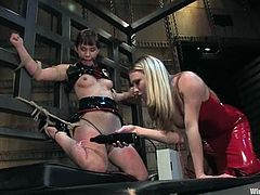 The submissive girl is going to go through some pretty fucked up bondage before getting face sit in this lesbian BDSM session.