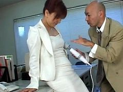 Japanese office babe Megu enjoys naughty time along her boos and this vibrator