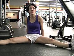 Press play on this hot scene and take a look at this naughty teen brunette sexy body ans especially her round ass while she exercises in the gym.