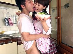 18 yo Japanese teen is in the kitchen and she's about to have breakfast only that this guy has other plans for the meal. He wants to fed her with his dick and the cute Asian teen kneels in front of him after he rubbed her cunt. The bitch look great with a cock in her mouth but what if she will get some jizz too