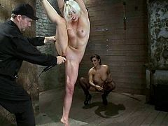 Slender blonde chick gets tied up by her master and mistress. Later on she gets her feet whipped and pussy fingered. Of course she also gets toyed with a vibrator.