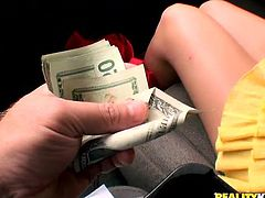 Press play to watch this tattooed blonde babe, with big jugs wearing a yellow miniskirt, while she gets fucked hard for a few green bucks.