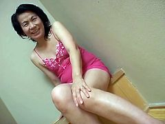 See this mature Asian slut takes off her pink dress and masturbates. She slides her playful fingers inside her hairy pussy until she cums for you all out there.
