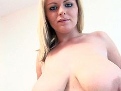 Cute blonde loves to pose and play naughty with her huge natural boobs
