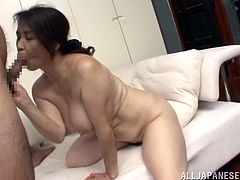 Yuuko is pussy licked by this guy and then, she opens her mouth wide, greeting his cock. The brunette mature sucks his cock like an obedient whore and after doing so, she bends over to get fucked. The dude drills her big booty and makes her moan with pleasure and pain.