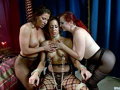 Punk slut Ariel is about to receive a harsh lesson from Berlin and Andre. The two mistresses love to punish and dominate cuties like her and so the fun begins. At first Ariel sits on a chair with clamps on her nipples and then she is laid on the bed, ass slapped and putted to lick pussy like an obedient sex slave