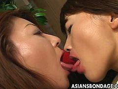 Asians Bondage brings you an amazing free porn video where you can see how two Japanese brunette belles go lesbo together as they make out and play with their pussies.