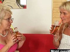 A chubby mature blonde and her salacious GF are having some good time together. They kiss and fondle each other and then finger each other's cunts and pound them with a strapon.