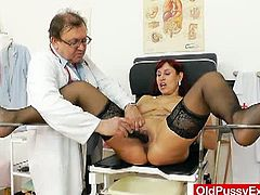 Red head granny Darja pussy gets gaped in the clinic by this horny doctor. You'd see that she's more than willing to give him her mature body for more than examinations.