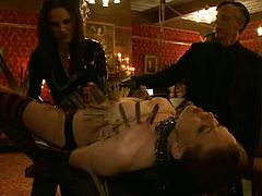 Bella Rossi and Lilla Katt get tied up and clothespinned. Later on they get whipped and gagged with ball gags.