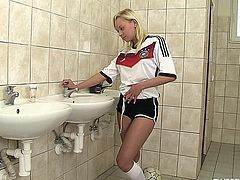 Naughty blonde German teen football player masturbating twat