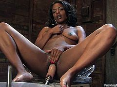 Sexy black chick Cadence Cohstly is having fun with a fucking machine. She rubs her sweet pussy ardently and then gets it pounded hard by the device.