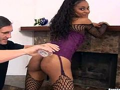 Click to watch this long haired ebony girl, with a sublime ass wearing fishnet stockings, while this dude puts oil on her black butt so he can nailed her!