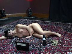 Chubby brunette milf Ashli Orion gets bound and hang up by Jack Hammer. Jack tortures Ashli and then rubs her vag with a toy.