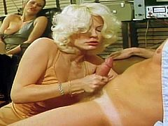 Pretty one and only stunning blonde porn goddess Seka with big hotoers and awesome body in tempting dress and lingerie gives head to her partner in vintage footage.