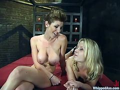 Sexy blonde chick gets tied up and then whipped in a basement by her nasty mistress. Later on she also gets toyed from behind.