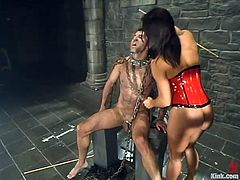 Sandra Romain is having BDSM fun with a dude called Totaleurosex. She puts the guy into chains and then attaches leads to his balls and makes him eat her coochie.