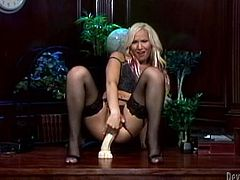 Khloe Hart the blonde tranny in black lingerie and stockings rides big dildo. Later on Khloe starts to stroke her dick.