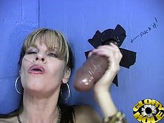 She is horny and naughty cougar who loves to watch porn and masturbate and this time she gets a gloryhole cock. Watch her sucking that rod.