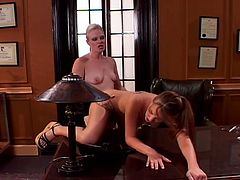 Blonde shorthaired boss is ready to have fun with her innocent secretary. She uses a huge strapon belt and penetrates her pussy so hard that she is ready to came.
