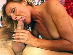 Ginger Spice gets pleased well by having a young dick slaming her shaved ass