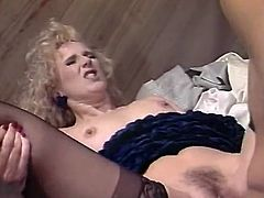 This curly-haired blondie looks very tempting in her sexy black stockings. Shapely cutie pleases her lover wiith a blowjob. Then she wants him to return the favor and eat her delicious fanny. Horny guy licks her pretty twat without hesitation and with pleasure.