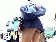 This unsuspecting Asian schoolgirl in mini skirt heading back home after school not knowing that a pervert guy is following her with a hidden camera capturing and recording what is hidden under her mini skirt.
