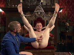 Adam is well known for his tastes in men. He's in his mansion now, playing with one of his boy toys. Adam makes him kneel and spanks him before tying him on that wooden chair. After he tied up his sex slave, Adam fingered his anus and then fucked it deeply. See how else he will play with this cheap whore.