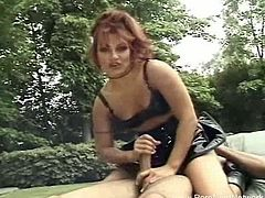 Check out this stunning redheaded milf covered in black latex giving out the handjob of her life. She strokes a lucky dude's cock to make him cum so easily.